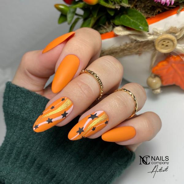 Paznokcie Gwiazdki na pomarańczowych paznokciach